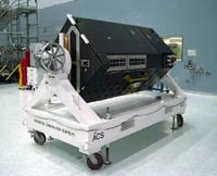 ACS - Hubble's newest scientific instrument on display in a clean-room before launch.