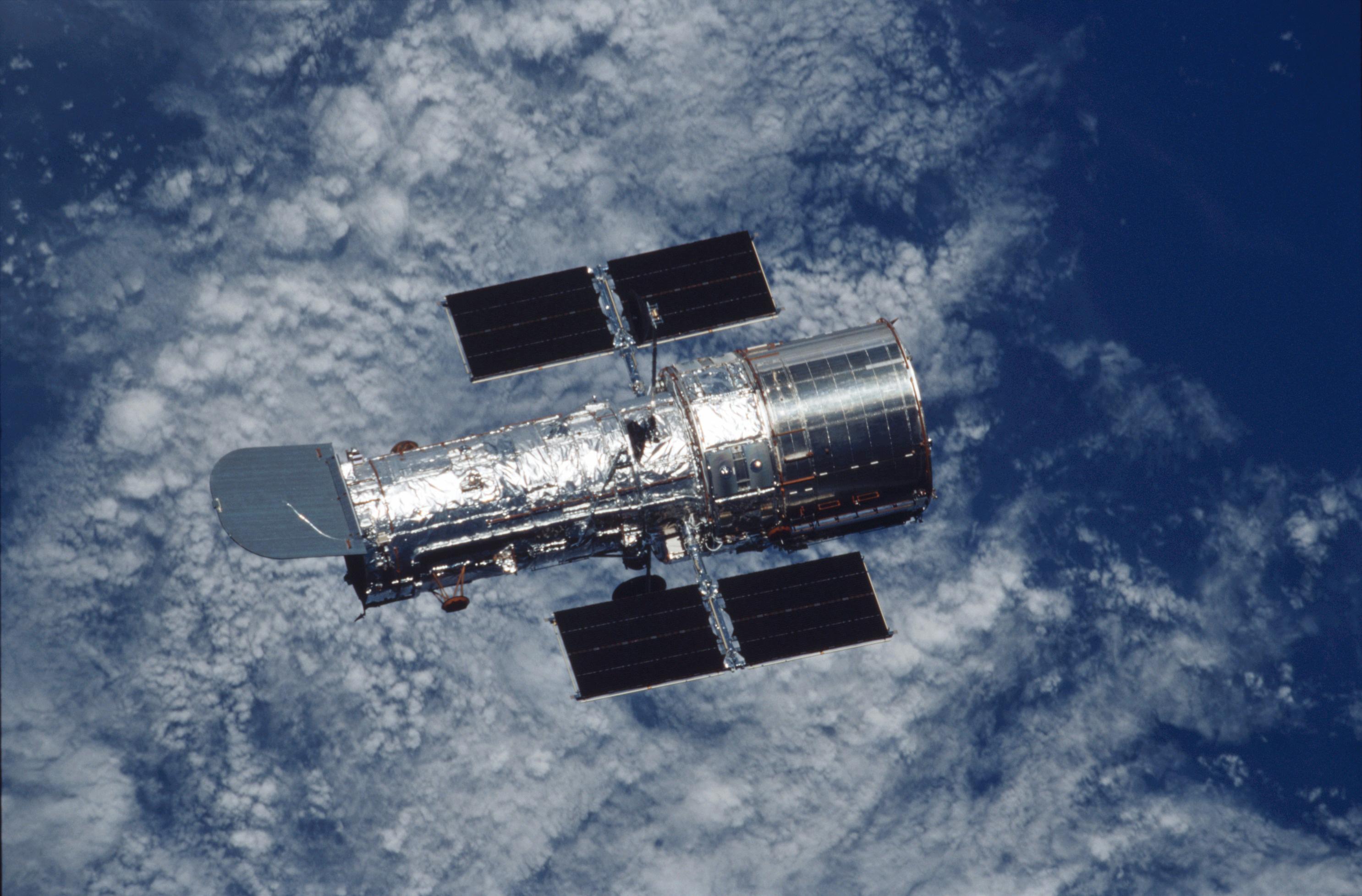 Hubble Space Telescope over Earth | ESA/Hubble