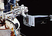 The 280 kg Wide Field Planetary Camera is easily lifted by the astronauts in the weightless environment of space.