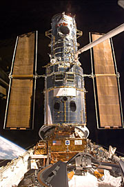 "Hubble has just been ""grappled"" by ESA astronaut Jean-François Clervoy. It is now being put on the ""berthing platform"" which has been specially constructed to accommodate the telescope during the repairs."