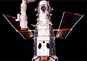 Hubble after capture with the remote manipulator arm. Ready for surgery!