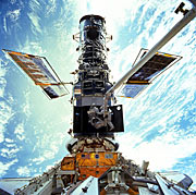 Hubble berthed in the Space Shuttle bay during Servicing Mission 3A.