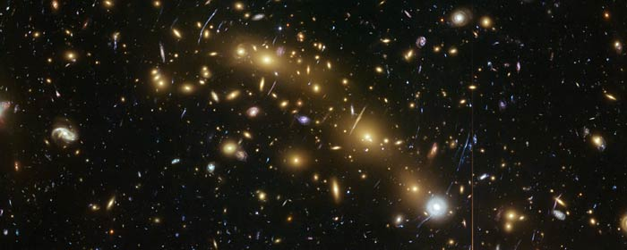 This image from the NASA/ESA Hubble Space Telescope shows the galaxy cluster MCS J0416.1–2403. This is one of six being studied by the Hubble Frontier Fields programme. This programme seeks to analyse the mass distribution in these huge clusters and to use the gravitational lensing effect of these clusters, to peer even deeper into the distant Universe.