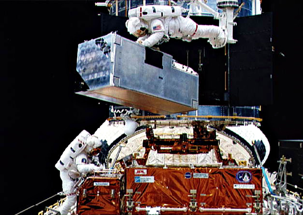 COSTAR being inserted into Hubble during First Servicing Misson.
