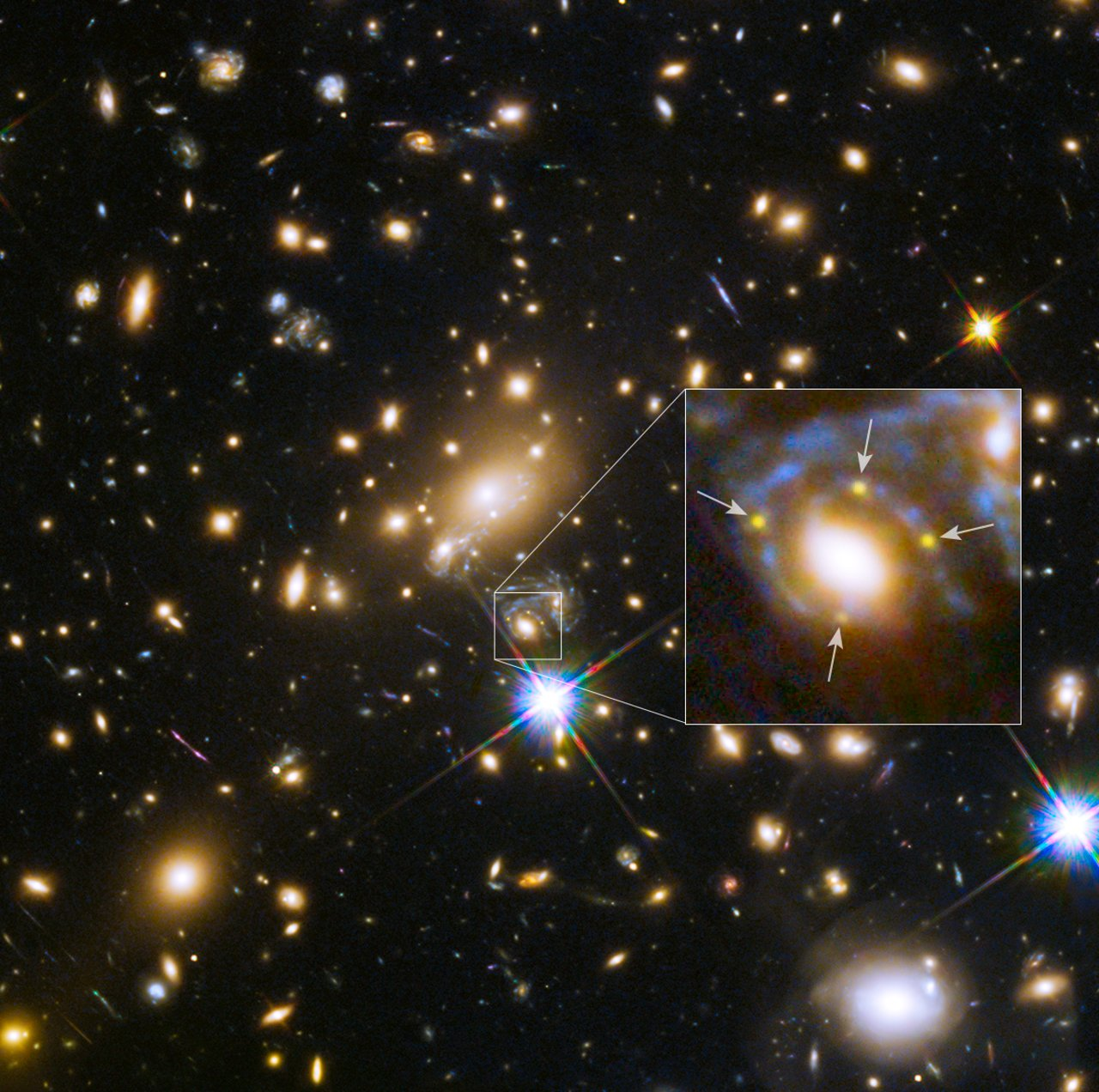 This image shows the huge galaxy cluster MACS J1149+2223, whose light took over 5 billion years to reach us.