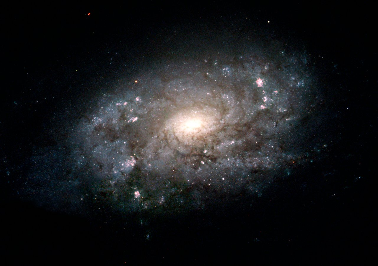 hubble images majestic cousin of the milky way esahubble